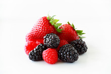 Pile Of Fresh Berries On A Whi...