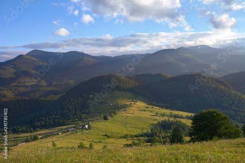 Fototapeta mountain summer valley in the rays of the sun. obraz na płótnie