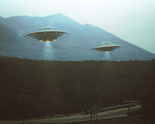 Unidentified Flying Object. Two UFOs Flying Over A Road Among The Trees. 3D Illustration Retro Photo Vintage. Noise And Defects Of Old Photo Film.