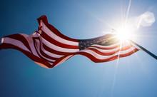 Sunburst Over American Flag Ag...