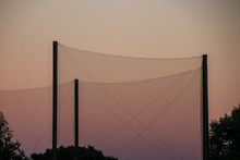 Netting Over Sports Field At Sunset