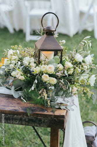 Wall Murals Cemetery Wedding reception head table decoration piece of lamp and flowers.