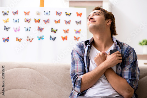 Student entomologist studying new species of butterflies