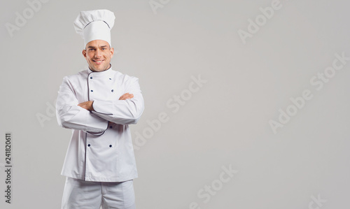 Fotografie, Obraz  Smiling man in uniform of cook