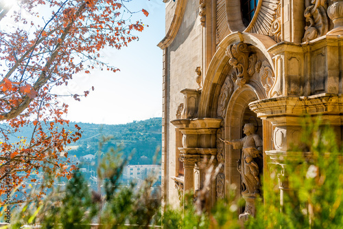 Foto auf AluDibond Barcelona close up view of front facade of Collegiate Basilica of Santa Maria Seu in Manresa city in catalunya region in Spain, with trees and clear blue sky during sunny day