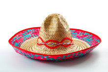 Cinco De Mayo, Traditional Mexican Hat And Caribbean Culture Concept Theme With Close Up On Wicker Or Straw Sombrero Decorated In Bright Colors Isolated On White Background With A Clipping Path Cutout