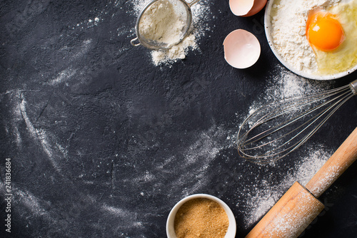 Cooking and baking utensils on black texture