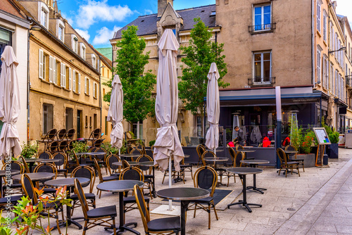 Foto  Old street with old houses and tables of cafe in a small town Chartres, France