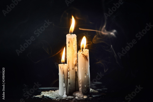 Group of white candles burning in the dark Canvas Print