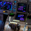 Close up of flight controls in an airplane cockpit