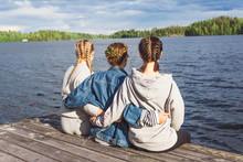 Girls Sitting On Dock With Bra...