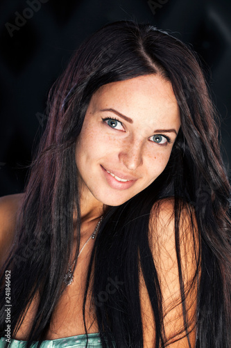Dimples and freckles, very cute smiling brunette girl. Fototapeta