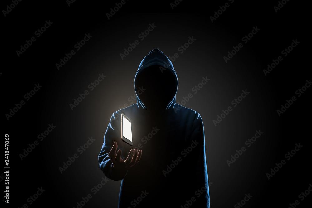 Fototapeta White smartphone floating above of hacker's hand in dark background. Finance, business, e-commerce or cyber crime concept