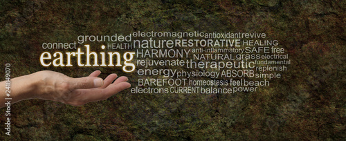 Obraz na plátně Earthing Word Cloud - female hand palm up outstretched with the word EARTHING fl