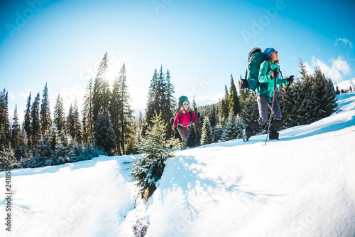 Two women in a winter hike.