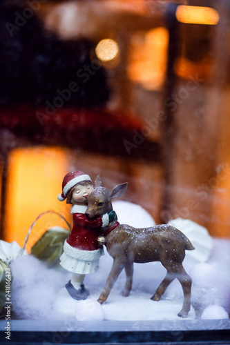 Foto  Cute Christmas scene in window