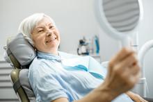 Happy Elderly Woman Enjoying H...