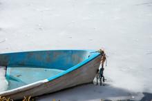 Abandoned Boat On Icey Lake