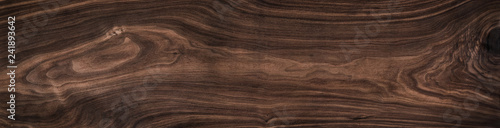 Super long walnut planks texture background.Dark tone walnut texture,Walnut natural texture.