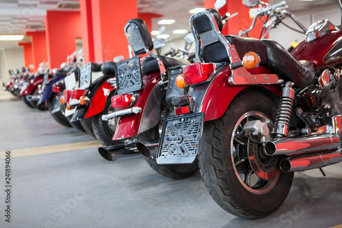 Line of top quality used motorcycles such as classic choppers is on sale. Bike shop or storage for winter laying-up and saving
