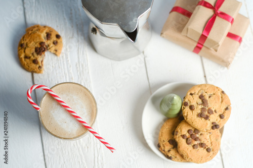 Christmas cookies with chocolate and coffee on the background of candles.