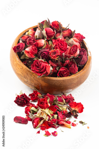Foto op Canvas Kruiderij Dried herbal roses tea on the white background