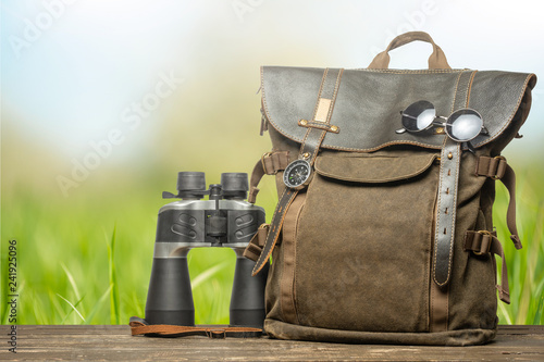 Foto  Vintage backpack, compass, sunglasses and binoculars