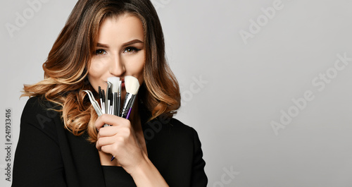 Fotografie, Obraz  Beauty woman hold makeup professional tools mascara eyelashes brushes have clear