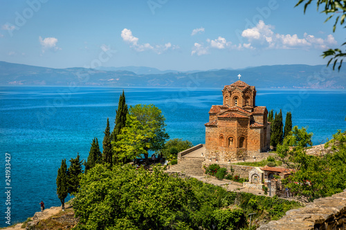 Fotografie, Obraz  An orthodox church with the beautiful Ohrid lake in a blue sky day