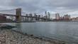 Manhattan skyline viewed from Brooklyn with Brooklyn bridge, in New York City, USA
