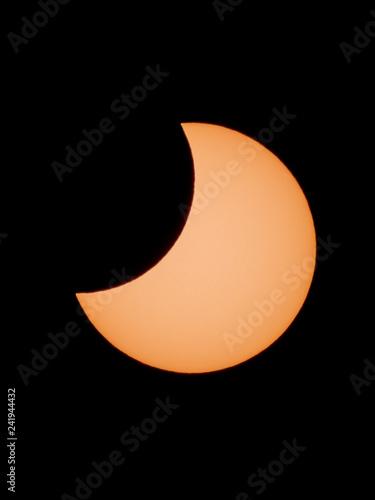 Partial Solar Eclipse through amateur telescope-refractor. Vladivostok, January 6, 2019.