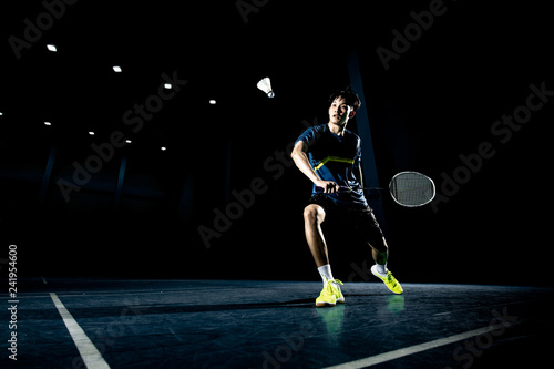 Obrazy Badminton   asian-badminton-player-is-hitting-in-court