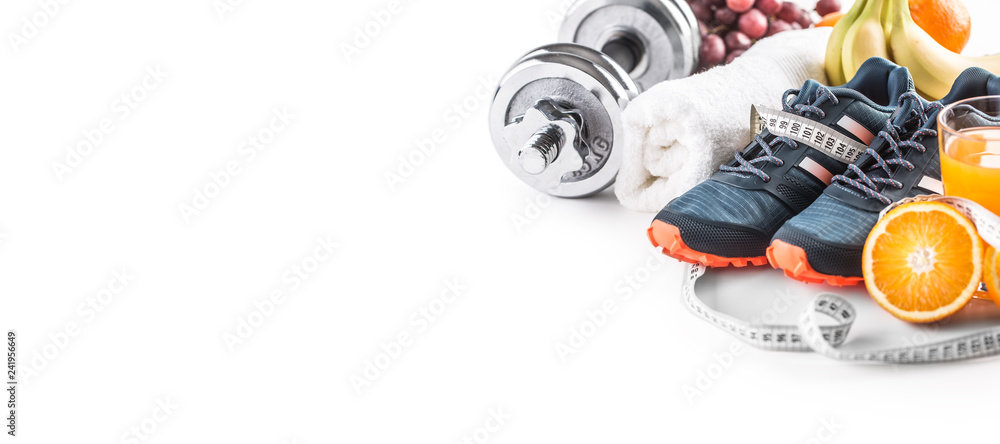 Fototapeta Sport shoes dumbbells fresh fruit measure tape and multivitamin juice isolated on white background. Healthy sport and diet concept.
