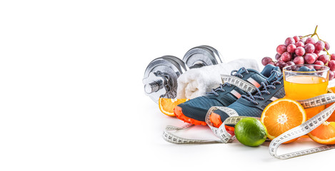 Sport shoes dumbbells fresh fruit measure tape and multivitamin juice isolated on white background. Healthy sport and diet concept.