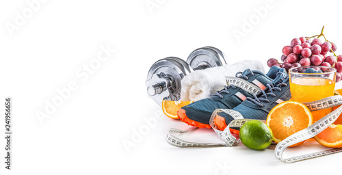 Obraz Sport shoes dumbbells fresh fruit measure tape and multivitamin juice isolated on white background. Healthy sport and diet concept. - fototapety do salonu