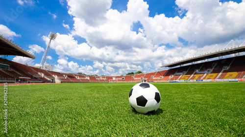 Fototapety, obrazy: soccer ball on soccer field green grass , football field  athletics stadium and blue sky background