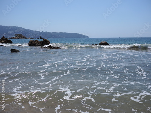 Fotografia, Obraz  Wonderful view of rocks at bay of ACAPULCO city in Mexico with Pacific Ocean wav