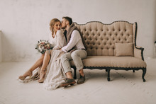 Happy Newlyweds Having A Rest At Home. Soft Focus
