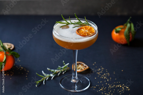 Christmas cocktail of amaretto sour with dehydrated clementine and rosemary Canvas Print