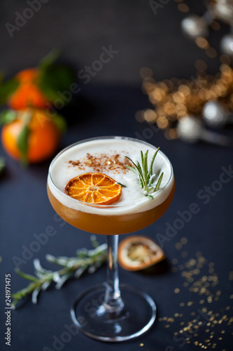 Stampa su Tela Christmas cocktail of amaretto sour with dehydrated clementine and rosemary
