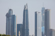 Beautiful architectural background. Panoramic view of Dubai's business bay at sunset.