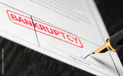 Macro shot of red stamp bankruptcy and fountain pen on a form. Canvas Print