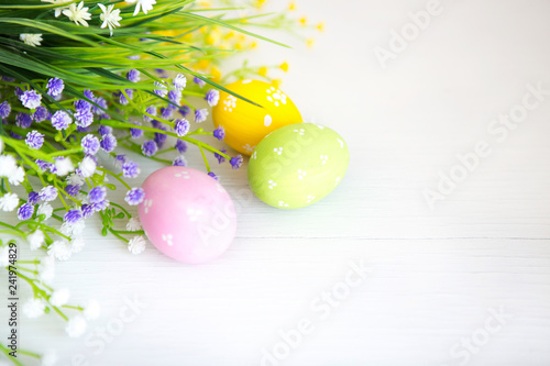 Garden Poster Narcissus Painted decorated easter eggs with spring flowers on white table