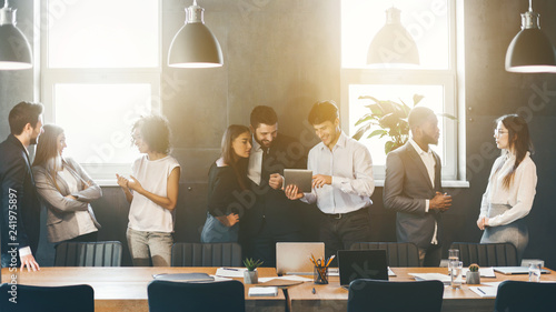 canvas print motiv - Prostock-studio : Successful business people talking during coffee break
