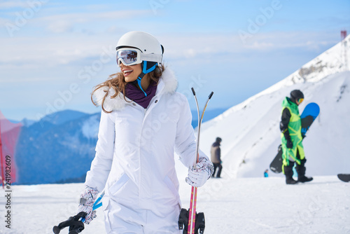 Fotomural woman skier close up portrait wearing white healmet with mask in snow winter mou