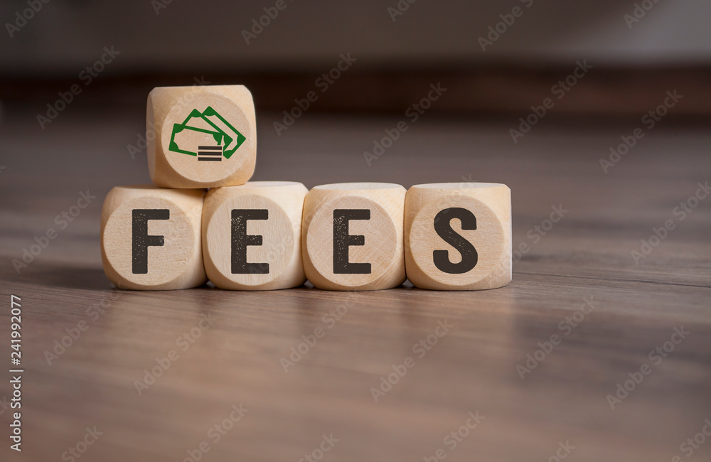 Fototapeta Cubes dice with fees on wooden background