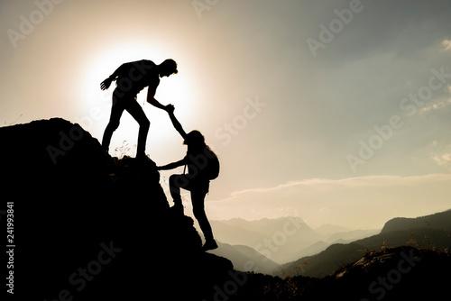 Fototapeta Mountaineers ' summit goal and accomplishments together obraz na płótnie