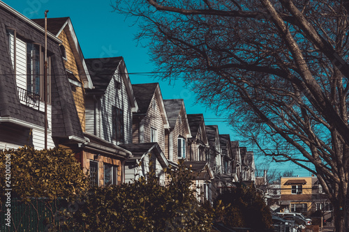 Row of colorful residential houses in Queens, NY Canvas Print