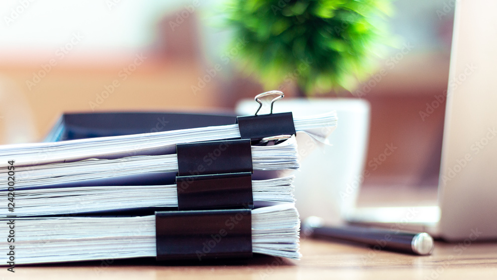 Fototapeta Stack of documents placed on a business desk in a business office.