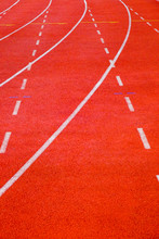 Close-up Running Track With Curve And Dash Lines